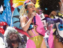Wayne Coyne of The Flaming Lips (L) and host Miley Cyrus perform onstage during the 2015 MTV Video Music Awards at Microsoft Theater on Aug. 30, 2015 in Los Angeles. (Kevork Djansezian/Getty Images)