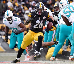 In this Jan. 8, 2017, file photo, Pittsburgh Steelers running back Le'Veon Bell runs during an AFC Wild Card NFL game against the Miami Dolphins in Pittsburgh. (AP Photo/Don Wright, File)