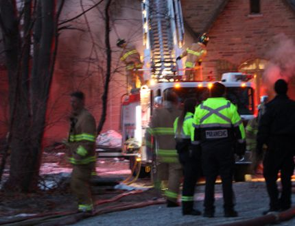 Sarnia firefighters continue to work a fire at a home in the 1600 block of Lakeshore Road Saturday evening. Residents escaped the fire but one man suffered burn injuries.NEIL BOWEN/Sarnia Observer