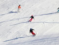 Emily Mountney-Lessard/The Intelligencer Skiers make their way down the hill at Batawa Ski Hill Sunday.
