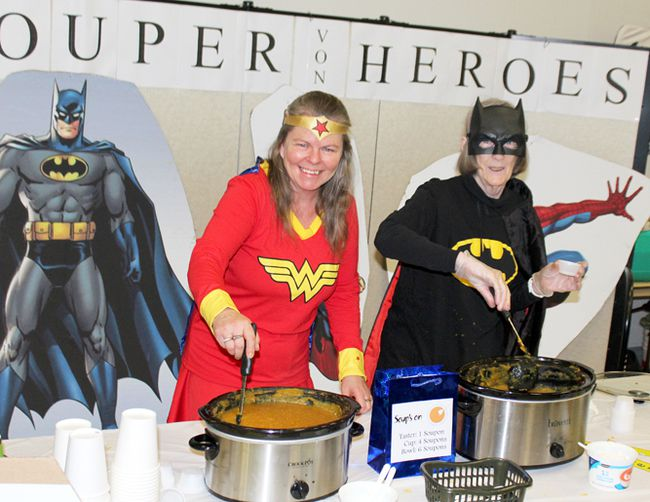 Mary Jane MacPhail, left, and Catherine Flanagan serve up pumpkin squash soup from the VON Perth Huron booth at the annual Alzheimer Society Soup's On fundraiser at the Rotary Complex on Saturday January 14, 2017 in Stratford, Ont. Steve Rice/Stratford Beacon Herald/Postmedia Network