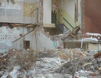 Photo by Patricia Drohan/For The Mid-North Monitor Caption: The demolition wall of the former building for Sacred Heart School gives those who pass by an inside a look inside to what used to be a busy stairwell.