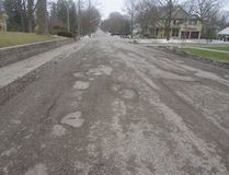 Potholes scar the asphalt on Light St. in the north end of Woodstock. (HEATHER RIVERS, Sentinel-Review)