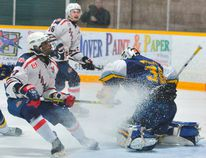 Sailors forward Michael Boateng rewards Dunnville goalie Brennan Head with a snowstorm after the netminder deflected a hard shot over the glass during Sunday's game at the Port Dover arena. The Sailors eked out an exciting 5-4 overtime win over the Mudcats. MONTE SONNENBERG/SIMCOE REFORMER