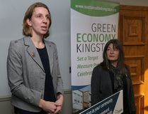 Sustainable Kingston executive director Ruth Noorderaaf and Kingston and the Islands MPP Sophie Kiwala handed out recognition certificates Monday at the Sustainable Kingston office. (Ian MacAlpine/The Whig-Standard)