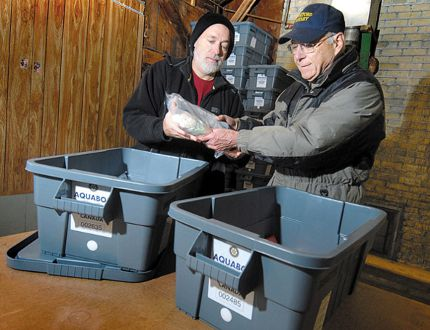 Rotary Club of Stratford members Dave Bean, left, and Gary Morris assemble aquaboxes destined for Haiti in this Beacon Herald file photo. SCOTT WISHART/Beacon Herald files