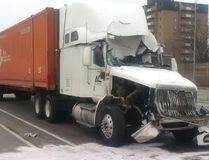 A damaged transport truck is shown in this Lambton OPP photo, via Twitter, following a collision Monday afternoon on Highway 402 near Christina Street in Sarnia. A Brampton resident has been charged with careless driving (Handout)