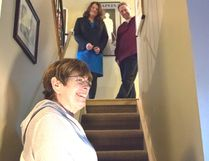 Sherwood Park's Jill Osborne and her husband Dave, watching from the top of the stairs — along with Seniors and Housing Minister Lori Sigurdson — are two of the 800 applicants to the province's Seniors Home Adaptation and Repair Program. Photo by Sarah Comber/Sherwood Park News/Postmedia Network