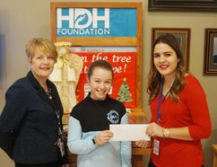 Nine-year-old Jaydan Rahn raffled off a number of items at her family's Christmas and raised $123 for the Hanover and District Hospital Foundation (HDHF). Jaydan (centre) presented her donation to hospital president and CEO Katrina Wilson and HDHF coordinator Angela Wainscott on Friday, Jan. 13. (Dave Flaherty)