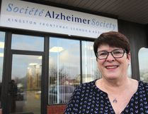 """Lesley Kimble, at the Alzheimer Society of KFL&A office in Kingston on Monday, is the fundraising co-ordinator for the society, which is starting a """"companion volunteer"""" program that pairs volunteers with people with dementia. (Michael Lea/The Whig-Standard)"""