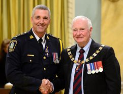 St. Thomas Police Chief Darryl Pinnell, left, accepts a member designation to the Order of Merit of the Police Forces from Governor General David Johnston last September at Rideau Hall in Ottawa.