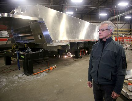 Bob Clark, contracts manager of MetalCraft Marine, looks at the upside down hull of a Firestorm 50 fire boat that is one of three boats going to the Istanbul Turkey Fire Department. (Ian MacAlpine /The Whig-Standard)