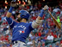 Jose Bautista of the Toronto Blue Jays hits a three run home run to left field agianst Jake Diekman of the Texas Rangers during the ninth inning in game one of the American League Divison Series at Globe Life Park. (Ronald Martinez/Getty Images)
