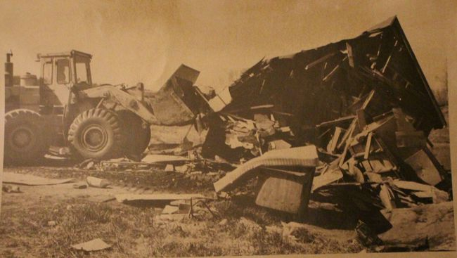 In this 1980 Today file photo, a bulldozer destroys a home belonging to a resident of Moccasin Flats near the Snye.