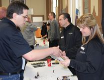 Don Duhaime, technical sales representative with Custom Concrete Northern in Timmins, chats with Kim Krcel, a representative of Primero Mining during the Meet The Purchasers event hosted by the Timmins Chamber of Commerce at the McIntyre Community Centre Tuesday. To Krcel's right is John MacFarlane, another Primero representative who met with prospective service and product providers. (Photo: Carmen Swartz/Timmins Chamber of Commerce)