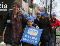 Tim Miller/Intelligencer File Photo Participants in the Coldest Night of the Year fundraising event stroll through Belleville's downtown core last February. This year's walk takes place Feb. 25.