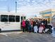 Agnes and Frank Lovsin present resident Jordan Hills with the keys to the new Sutherland Place recreational bus the couple generously donated to the facility on January 12 in Peace River. Joining them (back row from left to right) are staff members Sue Aubin, Lynn Gaydosh, Ivy Blanco, Valerie Roy, Trisha Towne, Brenda McCullough and Tamara McCloskey. Sutherland Place residents Yvon Sasseville, Jacqueline Milligan and Merv Hinson are pictured in the front row.