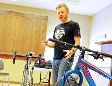 Peter Loewen of Country Cycle and ski discusses the particulars of winter cycling gear Jan. 14, 2017. (Alexis Stockford/The Morden Times)