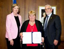 Pat Eyolfson of Arborg (middle) received the Lieutenant Governor's Award for Historical Preservation and Promotion from Lt. Gov. Janice Filmon (left) May 12, 2016 at Government House. The award is presented annually in consultation with the Manitoba Historical Society, represented by its president, Gary McEwen (right). (File photo)