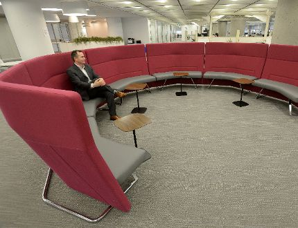 David Ciccarelli, chief executive of Voices.com, sits in a couch used for meetings at the new Voices.com office on the seventh floor of the Bell building at Dundas and Talbot streets in London. (MORRIS LAMONT, The London Free Press)