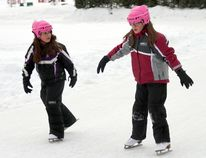 Sisters Hannah, left, and Kora Moreau enjoy the unseasonably warm weather at the Sk8te Hollinger rink on Wednesday afternoon. It was about -2 C at the time, which is 22 degrees above the average low temperature for this time of year.