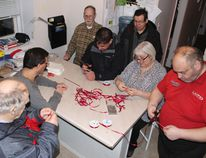 People First members assemble pins for their annual Red Ribbon Campaign in support of the Week of Action Against Poverty in Kenora, Feb. 12 - 18. Pictured from L-R: Russell Havill, Art Alcock, Tom Powell, Patrick Medicine, Robert John (R.J.) Gordon, Nan Normand, facilitator, and John McMillan, vice president. Reg Clayton/Miner and News