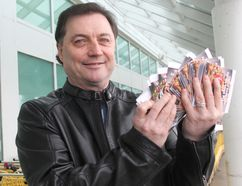 Tom Hedican, organizer of Coach4Food, holds $1,340 in grocery cards purchased with money raised through GoFundMe to help Joshua Blackwood and his fiance. Jennifer Hamilton-McCharles / The Nugget