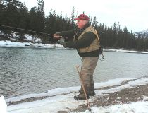 Neil casts a line for Athabasca River bull trout