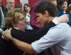 Prime Minister Justin Trudeau speaks with an emotional Kathy Katula, from Buckhorn, Ont. following a news conference in Peterborough earlier this month. Katula has come to symbolize the economic struggles of Canadians. (Adrian Wyld/The Canadian Press)