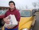 Cody Cuerrier, 19 with his 2002 Chrysler PT Cruiser in Kingston. (Ian MacAlpine/The Whig-Standard)