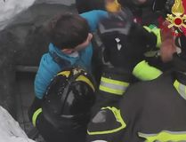 This frame from video shows Italian firefighters extracting a child alive from under snow and debris of an hotel that was hit by an avalanche on Wednesday, in Rigopiano, central Italy, Friday, Jan. 20, 2017. (Italian Firefighters/ANSA via AP)