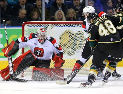 Sam Miletic of the Knights misses the bouncing puck as he closes on Oliver Lafreniere of the Ottawa 67's during their game at Budweiser Gardens in London, Ont. on Friday January 20, 2017. (MIKE HENSEN, The London Free Press)