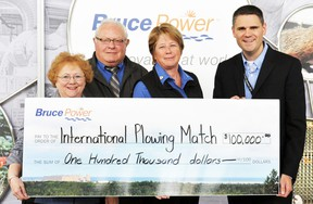 Cathy Lasby, left, executive director of the Ontario Plowman's Association; Graeme Craig, sponsorship chair of the International Plowing Match (IPM) and Rural Expo; and Jacquie Bishop, chair of 2017 IPM, receive a $100,000 cheque from James Scongack, Bruce Power's vice president of Corporate Affairs and Environment. Bruce Power is a Distinguished Partner of the IPM, which will take place in Walton, Huron County, from Sept. 19-23. It is expected to draw 100,000 people to Walton.
