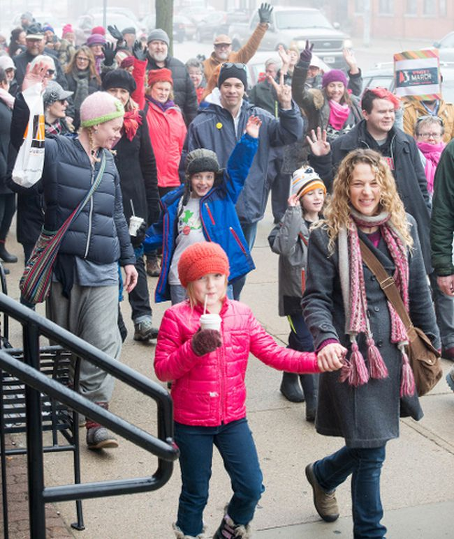Some of the scores of marchers who took to the downtown sidewalks of Stratford are shown Saturday. PHOTO COURTESY MINDY GOUGH