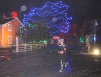 A participant enjoys the Christmas lights during the Dion Ignite the Night Snowshoe Race at Upper Canada Village on Saturday. Greg Peerenboom/Cornwall Standard-Freeholder