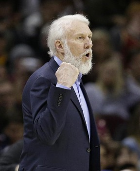 Spurs head coach Gregg Popovich yells to players during first half NBA action against the Cavaliers in Cleveland on Saturday, Jan. 21, 2017. (Tony Dejak/AP Photo)