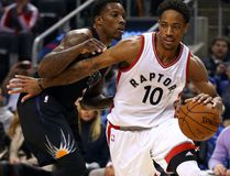 Raptors' DeMar DeRozan drives to the net against the Suns' Eric Bledsoe during NBA action at the Air Canada Centre in Toronto on Sunday, Jan. 22, 2017. (Dave Abel/Toronto Sun)