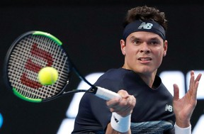 Canada's Milos Raonic hits a forehand to Roberto Bautista Agut during their fourth-round match at the Australian Open in Melbourne Monday, Jan. 23, 2017. (AP Photo/Dita Alangkara)