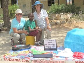Ashfield Township residents Suzanne Andrew and Anne Andrew are shown with one of the recipients of 5,000 bed kits delivered during Sleeping Children Around the World's 2015 Tanzania distribution. This particular bed kit was donated in memory of Peter Van Diepenbeek (Anne's brother), by Suzanne and her husband Bill. (submitted photo)