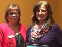 Carol Stahl, president of BPW Greater Sudbury, presents an award to Lisette Wirta, owner of Home Instead. Supplied photo