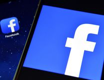 The Facebook app logo is displayed on an iPad next to a picture of the Facebook logo on an iPhone in London, England, in this Aug. 3, 2016 file photo. (Carl Court/Getty Images)