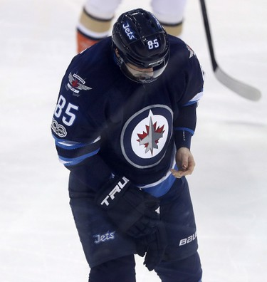Winnipeg Jets' Mathieu Perreault (85) bleeds from his thumb after taking a slash by Anaheim Ducks' Corey Perry (10) during first period NHL hockey action in Winnipeg, Monday, January 23, 2017. THE CANADIAN PRESS/Trevor Hagan