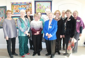 Members of the Lakeshore Traditional Rug Hook Crafters stand in front of a collection of their art at Gallery in the Grove on Jan. 15. The group of artisans are displaying their wool hangings at the gallery until Feb. 25 and will also be providing demonstrations on traditional rug hooking throughout the month. CARL HNATYSHYN/SARNIA THIS WEEK