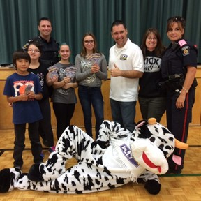 A $300 donation to Sudbury's Ecole St-Joseph was made thanks to a partnership with the Greater Sudbury Police and KICX 91.7 radio. Supplied photo