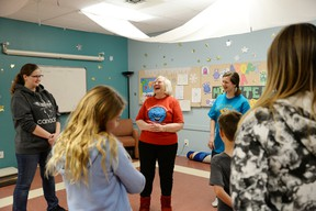 Noel Cairney teaches participants of her LOL 101 session the benefits of laughter — even if it means laughing to simply enjoy being happy. She is holding a weekly class at the Stony Plain Public Library. - Photo by Marcia Love