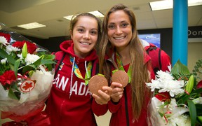 Jessie Fleming and Shelina Zadorsky, right, show off their two Olympic bronze medals earned on the women's soccer team in Rio in August. (MIKE HENSEN, The London Free Press)