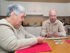 Judy Johnson (left) and Brent McEachern are adults with developmental disabilities who live with Kathy Deane, a LifeShare provider. (Brian Thompson/The Expositor)