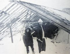 Joe and John Undusko check out what's left of a greenhouse on their farm in Waterford after it collapsed beneath the immense amount of snow that blanketed Norfolk County and beyond in the Blizzard of '77. The intense storm – which began 40 years ago Saturday and paralyzed the local area for a week -- damaged dozens of greenhouses and other buildings in the local area. POSTMEDIA FILE PHOTO