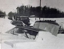 """Scenes like this at the intersection of Highway 24 and Highway 59 were common in Norfolk and Haldimand in the aftermath of the Blizzard of '77. The original """"Snowmageddon"""" began 40 years ago Saturday and paralyzed the local area for a week. POSTMEDIA FILE PHOTO"""