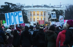 Protesters gather outside the White House at the finish of the Women's March on Washington on January 21, 2017 in Washington, D.C. Large crowds attended the anti-Trump rally a day after U.S. President Donald Trump was sworn in as the 45th U.S. president. (Photo by Mario Tama/Getty Images)
